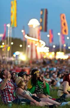 Festival goers watch the world cup football match between Croatia and Brazil at The Isle of Wight Festival