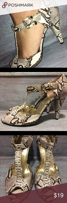 """Colin Stewart T-strap peep toe, snakeskin pattern Off white & beige, neutral shades in a snakeskin design.  T-strap peep toe style. Heels are 4"""" tall.  Gently used, only worn a few times. Love these sexy heels but they are just too high for me nowadays. Colin Stuart Shoes Heels"""
