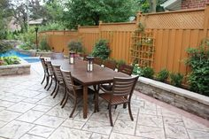 This concrete patio turns a side yard into a usable dinning area for entertaining guests. Great stamp work too! Durham Concrete ltd Whitby, ON Stamped Concrete Pictures, Stamped Concrete Driveway, Concrete Driveways, Poured Concrete, Concrete Patio, Pattern Concrete, Concrete Design, Brick Border, Alpine Garden