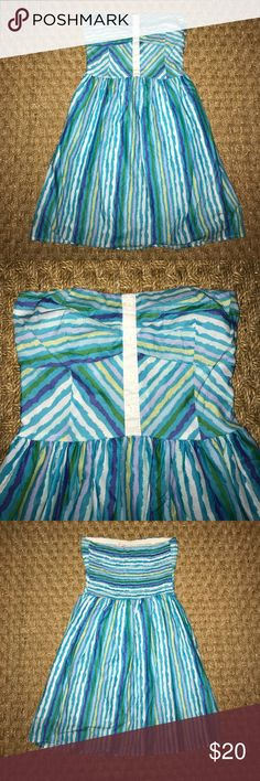 Cute summer number! (Runs small) All shades of blue striped strapless dress in perfect condition. Only worn twice!  It does have an inner lined fabric. Button up detail up top and stretchy across the back.. it is a size medium but definitely fits like a small or XS scott Dresses Strapless