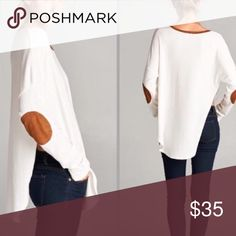 """NWOT Elbow patch tunic🎀 NWOT:Ivory Elbow patch tunic. Ribbed knit tunic with faux suede elbow patches and neckline trim. Side slits to above waist area. 62% polyester 34% rayon and 6% spandex. Bust measurement is 21"""" and length is 28"""" 🍁💕 picture is not mine Tops"""