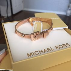 MK Cuff Belt Rose Gold Bracelet New never used with tags. Gorgeous rose gold bracelet. Snap open and close style. Comes with box and bookletNo trades Michael Kors Accessories