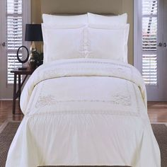 Modern Ivory Medallion Fleur de Lis Pattern Embroidered Duvet Comforter Duvet Cover and Shams Set. Bedding set is made of luxury 100% egyptian cotton for softness and comfort. Chic quality 5 stars hotel style bedding