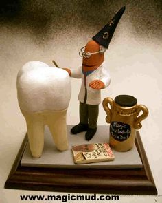 Dental Wizard works His Magic Customized gift for a Dental  Surgeon any orthodontist, periodontist, endodontist, prosthodontist or general dentist is made to order- as well as any other occupation! by www.magicmud.com 1 800 231 9814  $200-250 #dentist#endodontist#dental#dentistry#orthodontist#periodontist#prosthodontist#OralSurgeon#graduation#office-gift #anniversary #birthday #cake toppers#figurine#gift#wizard