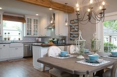 The new layout opens the kitchen to the dining area, allowing natural light to spill into the entire room via windows and newly-installed French doors.