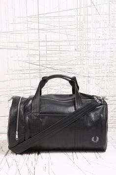 Fred Perry Black Perforated Barrel Bag at Urban Outfitters