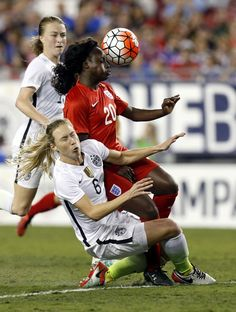 Defender Whitney Engen #6 of the United States collides with forward Eniola Aluko #20 of England during the second half of the 2016 SheBelieves Cup soccer match on March 3, 2016 at Raymond James Stadium in Tampa, Florida.