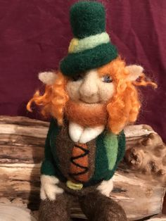 The Leprechaun is sitting on a small wooden plague, he is not permanently attached to the base but I can securely attach him if required.Handmade With Natural Wool. Needle Felted Animals, Needle Felting, Irish Leprechaun, Pumpkin Hat, Felt Gifts, St Patrick's Day Gifts, Quirky Gifts, Soft Sculpture, Sculptures