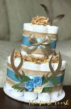 The Posh Toosh Specialty Diaper Cakes make perfect baby shower centerpieces and décor, baby shower gifts, nursery décor, and a unique and practical gift for a mommy-to-be! 2 Tier Blue Rustic Boho Chic Deer Antler Floral Diaper Cake with feathers Deer Baby Showers, Boho Baby Shower, Baby Shower Fall, Baby Shower Cakes, Baby Shower Parties, Baby Shower Themes, Baby Boy Shower, Baby Shower Gifts, Shower Ideas