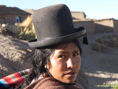 Part two of the Peruvian look -- a hat that sits high on your head. prefereably black. http://images.travelpod.com/users/ollieinamerica/1.1258570792.lady-in-traditional-bowler-hat.jpg
