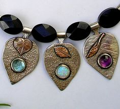 Leaves necklace Onyx silver gold Blue Topaz by HedvaElanyJewelry, $499.00