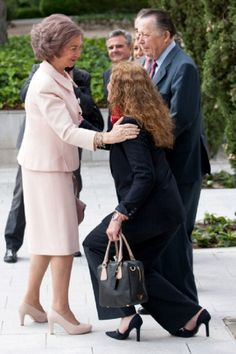 (R) Spanish  Infanta Elena curtseying to her mother Queen Sofia as they met at Mapfre Foundation and Carlos de Borbon Dos Sicilias (2R) on 20.05.2014 in Madrid, Spain.
