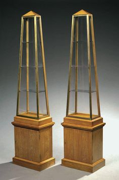 André Arbus (1903-1969) : pair of elegant neo-classical obelisk cabinets. On parallelepiped wooden base (oak) - André Arbus is a french prominent architect, décorator et sculptor of the XXth Century, born in Toulouse on 17 november 1903, he died on 12 december 1969.