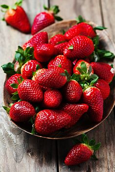 Photograph Sweet fresh stawberry on the wooden table by Oxana Denezhkina on 500px