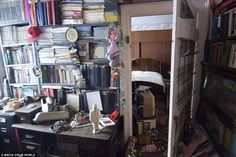 The study is packed wall to wall with books, papers and trinkets. 'In and around this desk were stacks of magazines and files and binders stacked to the ceiling,' Dave said. 'Underneath and on either side were filing cabinets packed full of paperwork and bills and medical files'