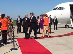 King and Queen of the Netherlands being escorted by Gov. Snyder.