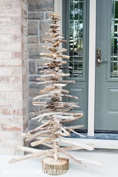DIY rustic driftwood evergreen/Christmas tree tutorial. A unique alternative to the traditional tree for a little coastal feel to your holiday decor, or a fun front porch decor all year round. SustainMyCraftHabit