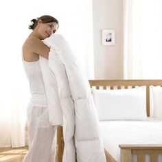 Luxurious and cosy sleep with natural fibers of goose feather. Sleeping on a cloud