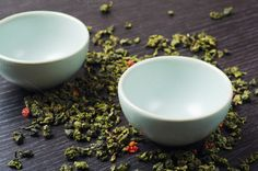 bowls with green oolong tea and strawberries by Mellisandra on Creative Market