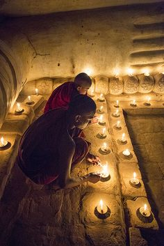 Noive monks light candle at the feet of the Reclining Buddha ,Bagan | by Marty Windle -Travel Photographer