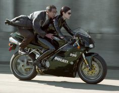 Way-past Badass--Trinity on a Ducati!!!!! CarrIe-Anne Moss