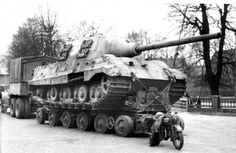 a Jagdtiger captured by British forces after its crew abandon it. the heavy tank destroyer is being ready to be sent to England for testing and evaluation. Although nominally powerful, the tank was prone to breakdown and fire and hated by its crews. For all its size and power it was notoriously ineffective unless handled by skilled crews, which were in short supply. Not very many were made.