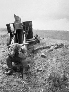 A German soldier keeps his head down in despair as his friend lies dead beside him. Kursk, 1943  (via http://www.pinterest.com/samiare47/)