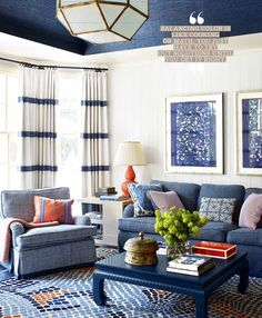 Loving room. Playroom. Colorful family room. Love the drapes the rug and the pops of orange.
