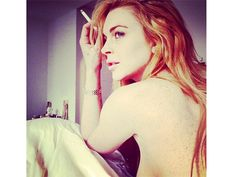 Lindsay+Lohan+looks+deep+in+thought.+Perhaps+she's+pondering+the+effects+of+gravity+and+hard+living.