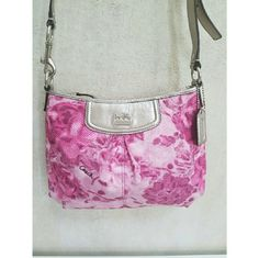 """NWOT Coach Madison Swingpack 47594 New with out tags. Authentic. Please look this purse up by its style number 47594 and its name to authenticate that it is a genuine Coach bag. It is a smaller and newer bag it does not have a creed stamp. One main zipper compartment with one interior flip side pocket. Pink satin lining. Approximately 9.75"""" x 7.5"""" x 2"""". NO TRADES Coach Bags Crossbody Bags"""