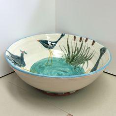 Side view . Waterbirds doing waterbirds stuff . Giant fruit bowl.