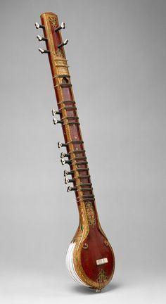 Sitar, late 19th century, India, 81.3cm. This small sitar has a body made of bent strips of wood. The strips are bent to form a bowl resonator that resembles the shape of small sitars that use ostrich eggs for the resonating chamber.