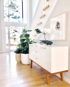 Plant and console We love how our Modern Media Console fits into entry way! What a bright and inviting space ✨⠀⠀⠀⠀⠀⠀⠀⠀⠀⠀⠀⠀⠀⠀⠀⠀⠀⠀⠀⠀⠀⠀⠀⠀⠀⠀⠀ Home Living, Living Room Decor, Living Spaces, Luxury Interior Design, Home Interior, Design Interiors, Cosy Home, Mid Century Sideboard, Home Decor Inspiration