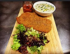 Veal snitzel with dried-tomato sause potato puree with chives and salad