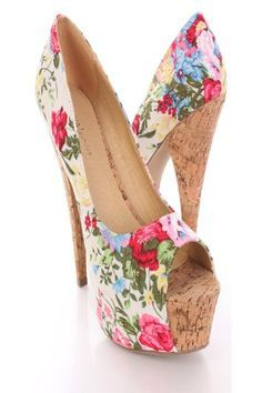 These stylish platform pump heels are a must have! Featuring floral print fabric upper with cork platform and heels, smooth lining, and cushioned footbed. Approximately 6 inch heels and 1 3/4 inch hidden platforms.