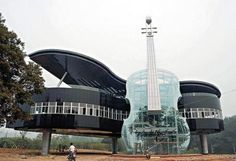 The Piano House located in Huainan City, Anhui Province, China. This contains a transparent violin and a piano building. Inside the violin, a staircase takes the visitors up to the piano. Unusual Buildings, Interesting Buildings, Amazing Buildings, Amazing Houses, The Piano, Grand Piano, Piano Guys, Piano Man, Architecture Unique