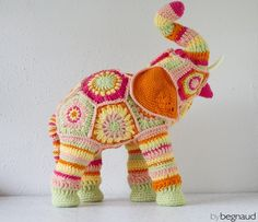 Hand crocheted elephant soft sculpture approximately 20 inches tall and 16 inches long. Pink, green, yellow, and orange yarn crocheted around an elephant shaped figure. Crochet Mandala Pattern, Crochet Toys Patterns, Crochet Crafts, Crochet Yarn, Yarn Crafts, Crochet Flowers, Hand Crochet, Crochet Projects, African Flower Crochet Animals