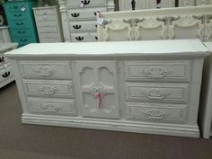 $255 - This 9 drawer dresser has been painted and distressed, all original matching hardware. It measures approximately 72 inches across the front, 19 inches deep, and 31 inches tall. It can be seen in booth H 13 at Main Street Antique Mall 7260 East Main St ( E of Power Rd ) Mesa 85207 480 924 1122 open 7 days 10 till 530 Cash or charge 30 day layaway also available