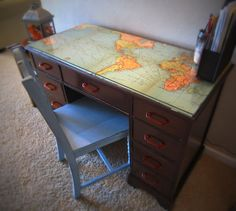 Mod podge an old map onto an antique desk to give it some beautiful charm! Charming Imperfections