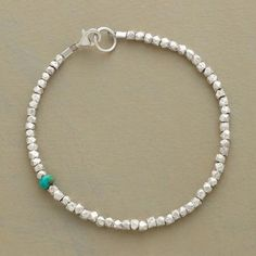 """SINGULAR MOMENT BRACELET - A single rondelle of turquoise makes a surprise appearance among faceted sterling silver nuggets in a bracelet you'll want to wear every day. Made in USA. Exclusive. Approx. 7-1/4""""L."""