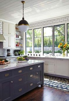 white kitchen/white subway tile backsplash/navy blue island/shiplap ceiling/Mesmerizing blend of traditional and modern in Nashville