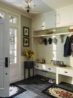 The upside of New England style is that it allows you (without any diversion from the key look) to create bags of storage. We love this clever combo, which is perfect for keeping everything neat that you'd ever find in a typically busy family hallway.  Inspiration from www.thecaliforniacompany.co.uk #shutters