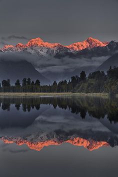 Sunset Reflection Of Lake Matheson, with Mount Tasman and Mount Cook, NZ, by Colin Monteath,
