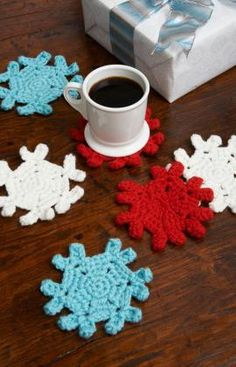Free crochet pattern using Red Heart Super Saver yarn. Protect surfaces while adding colorful personality to family gatherings with these fun crochet snowflake coasters Christmas Crochet Patterns, Holiday Crochet, Crochet Snowflakes, Crochet Home, Crochet Crafts, Crochet Yarn, Yarn Crafts, Crochet Projects, Free Crochet