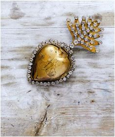 gold heart with diamonds