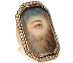 A Georgian lover's eye ring with pearl surround; the clouds signify that the person has died. (georgianjewelry.com)