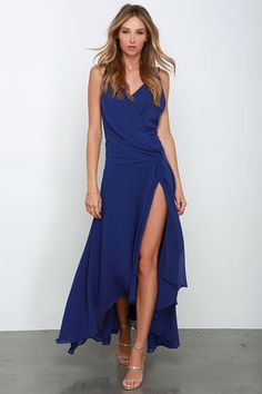 Whether for a cross-country adventure, or weekend getaway, you'll really wow wherever you go in the Romantic Rendezvous Royal Blue High-Low Dress! This breezy chiffon beauty has adjustable spaghetti straps that top the triangle bodice with billowy surplice front. Rows of pleats decorate the waist, while the floor-length tulip skirt flutters effortlessly to a high-low hem. Hidden back zipper with clasp.