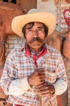 Jose Garcia Antonio - has lost his sight yet still produces beautiful pottery. Mexico Magic photos by John Running.