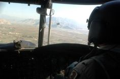 U.S. Army 1st Lt. Brent Hilzendager flies a CH-47 Chinook helicopter during a resupply mission throughout Afghanistan Jan. 5, 2007. Hilzendager is assigned to Alpha Company, 7th Battalion, 158th Aviation Regiment, 10th Combat Aviation Brigade, 10th Mountain Division