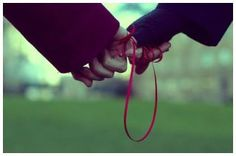 I would love a picture like this. I want cesar and I to wear a red strong around our ankles for the wedding. Goodle the red string of fate or destiny.